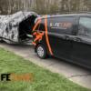 SafeClimb Car pulling a climbing wall on a trailer